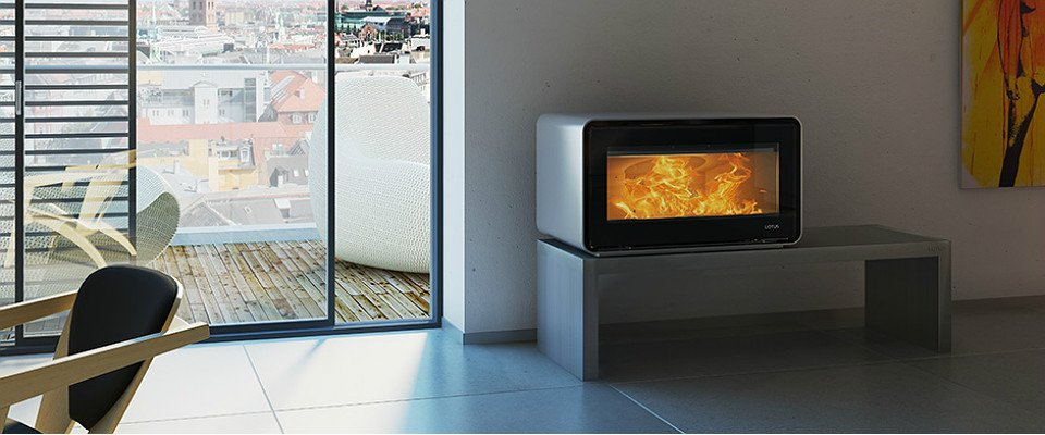 Lotus Living woodburning stove with ice metallic concrete bench